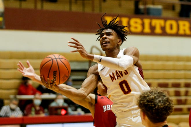 McCutcheon's Joe Phinisee (0) goes up for a layup during the fourth quarter of an IHSAA boys basketball game, Thursday, Feb. 4, 2021 in Lafayette. Phinisee scored 33 points Friday night as the Mavericks beat Marion