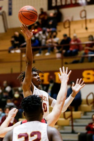 McCutcheon's Joe Phinisee (0) goes up for a shot during the fourth quarter of an IHSAA boys basketball game, Thursday, Feb. 4, 2021 in Lafayette.