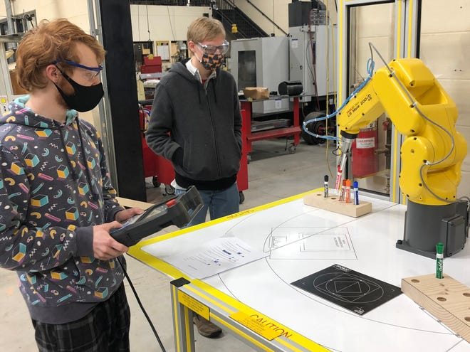 Students work with some of the state-of-the-art equipment used in the Industry 4.0 Partnership that includes the Oostburg, Random Lake, Elkhart Lake and Kiel Area school districts.