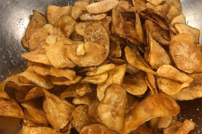 Potato chips by new Milwaukee maker Champion Chips come in unusual flavors, such as bacon cheddar, sriracha ranch and truffle Parmesan black garlic.