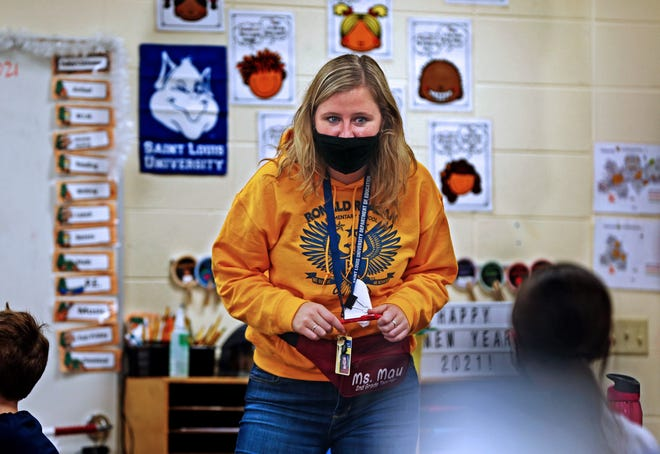 Second grade teacher Lauren Mau teaches at Ronald Reagan Elementary School on Friday, Jan. 22, 2021. Mau is among the school staff who help make schools run during a pandemic.