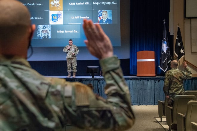 Lt. Gen. B. Chance Saltzman, U.S. Space Force deputy chief of Space Operations for Operations, Cyber and Nuclear, leads Airmen in a ceremonial oath of office and enlistment into the Space Force during a transfer ceremony on Maxwell Air Force Base, Alabama, Feb. 2, 2021.