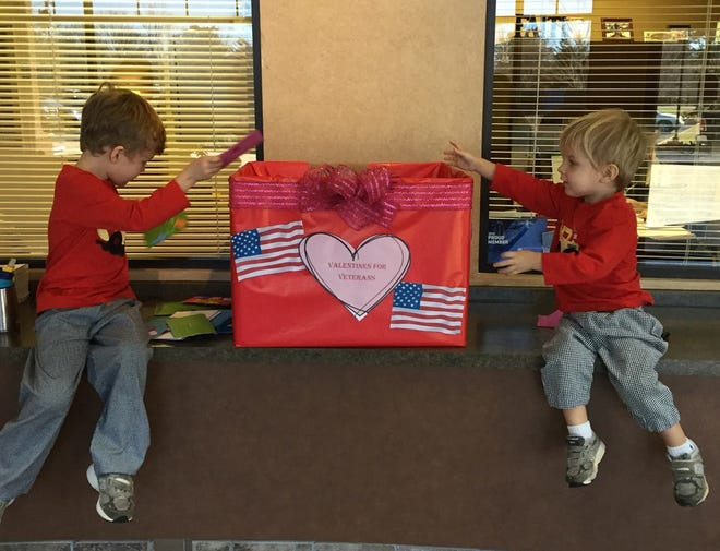 Two young residents donate cards to the Pike Road Valentines for Veterans card drive. Contactless card drop-off will be available, during normal business hours,  at Town Hall and Founders Station through Feb. 12 at noon.