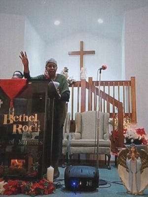 Minister Mary Jane Miflin speaks at Bethel Rock in Newark.