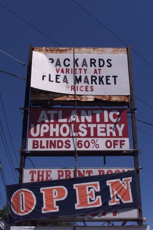 A Packard's sign on Main Street in Hackensack hangs bent on July 5, 2000.