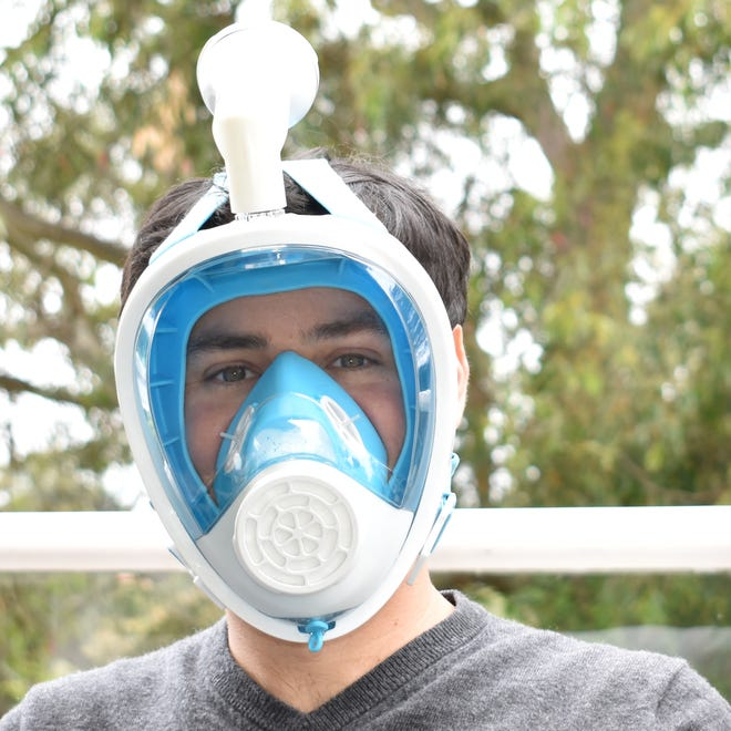 Narwall Founder Alex Rattray wearing the mask he designed, which was inspired by scuba gear technology and uses filters for inhaling and exhaling.