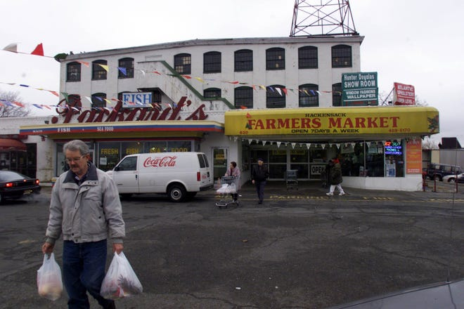 A shopper leaves the old Packard's market in Hackensack on Dec. 15, 1999.