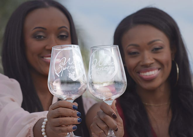 """Shaunna Cooper (left) and Shayla Smith are the """"two bold wine-loving sisters"""" behind Wine Spencer, a contemporary wine tasting events company."""