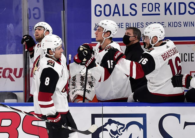 Feb 4, 2021; St. Louis, Missouri, USA;  Arizona Coyotes center Nick Schmaltz (8) is congratulated by left wing John Hayden (15) and center Derick Brassard (16) after scoring during the first period against the St. Louis Blues at Enterprise Center. Mandatory Credit: Jeff Curry-USA TODAY Sports
