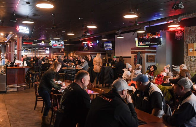 """People people fill the dining area for a """"burger weekend"""" fundraiser for Brandon Valley football coach Chad Garrow, who is fighting cancer, on Friday, Feb. 5, at Tailgators in Brandon."""