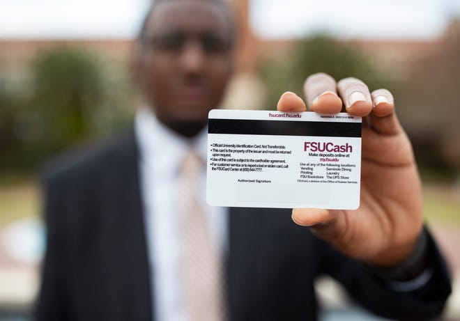 Travis Waters shows the back of his FSU ID card. He and his friend Alfredo Alvarez played an instrumental role in getting Florida State University to add a signature space to the back of FSU ID cards. This makes it easier for students to use the card at voting precincts.