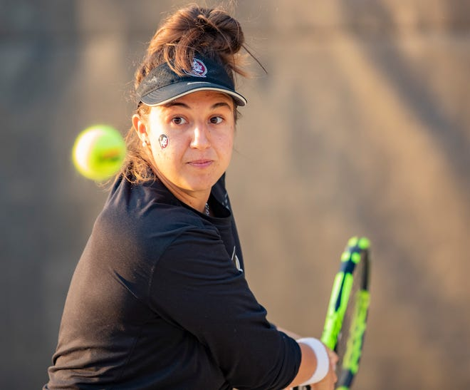 Florida State's Giulia Pairone watches the ball as she prepares to hit the ball. The Florida State Seminoles beat the Florida Gators 4-1 Thursday, Feb. 4, 2021.