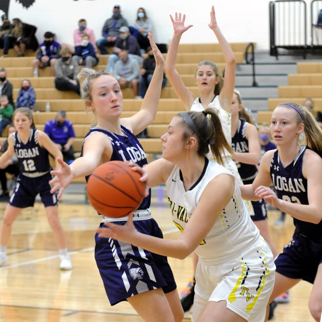 Tailor Dupler looks for a teammate while being trapped by defenders during Tri-Valley's 55-47 win against visiting Logan on Feb. 4 in Dresden.