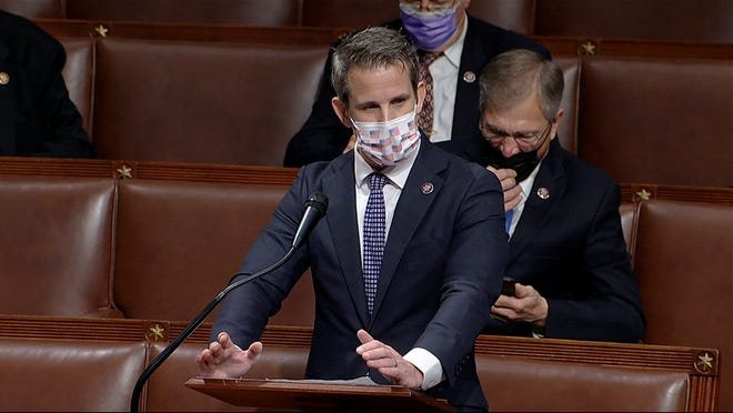 In this image from video, Rep. Adam Kinzinger, R-Ill., speaks as the House debates the objection to confirm the Electoral College vote from Pennsylvania, at the U.S. Capitol early Thursday, Jan. 7, 2021. (House Television via AP) ORG XMIT: WX413