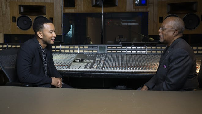 "Harvard professor and author Henry Louis Gates Jr., right, talks to singer John Legend, a fellow executive producer on Gates' PBS documentary, ""The Black Church: This Is Our Story, This Is Our Song."""