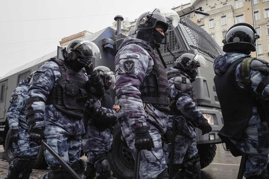 Russian police forces arrive to the scene of a protest in Moscow on Jan. 31, 2021.