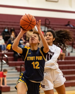 Brandy Beraud takes a shot for Stony Point as Round Rock's Suma Kasarla defends. Stony Point won a District 25-6A  girls basketball game at Round Rock 63-46 on Friday.