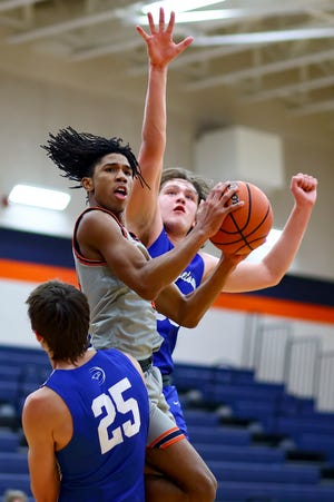 Trae Leak slices through Georgetown defenders to score a layup for Glenn in the first half of a District 25-5A game Feb. 5 at Glenn High School. Glenn held off a Georgetown rally at the end of the fourth period for a 52-49 win.