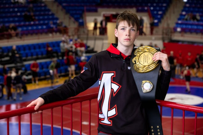Reese Braswell poses with his 2021 Outstanding Wrestler Award belt during a GHSA Class 4A Region 8 traditional wrestling tournament at Jefferson High School. Braswell, who has cerebral palsy, is a sophomore at Madison County High School and competes in the 113-lbs. weight class. (Casey Sykes for The Athens Banner-Herald)