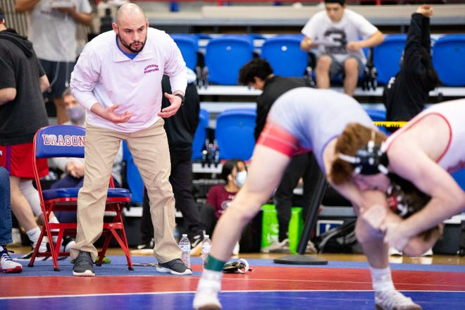 Jefferson wrestling head coach Kyle Baird coaches one of his athletes in a match during a GHSA Class 4A Region 8 traditional wrestling tournament at Jefferson High School. (Casey Sykes for The Athens Banner-Herald)
