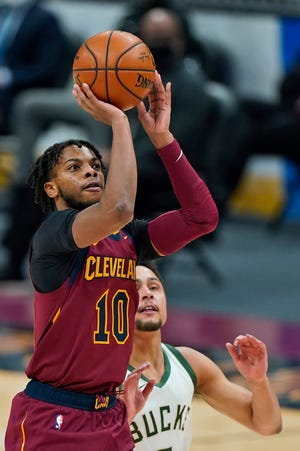 Cavaliers guard Darius Garland (10) shoots against the Milwaukee Bucks in the second half of the Bucks' 123-105 win Friday night at Rocket Mortgage FieldHouse. [Tony Dejak/Associated Press]