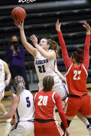 Isi Palamone (21) of Mount Union, shown in an earlier game, led the Purple Raiders over Heidelberg on Friday night with a career-high 22 points.