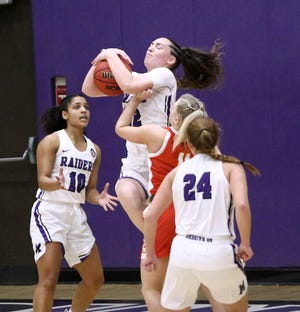 Mount Union's Bri Gassman brings down an Otterbein rebound during conference action at Mount Union Friday, February 5, 2021.