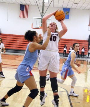 Ardmore's Reagan McCurley tallied 24 points Friday as the Lady Tigers held off McAlester in overtime for a 72-68 victory.