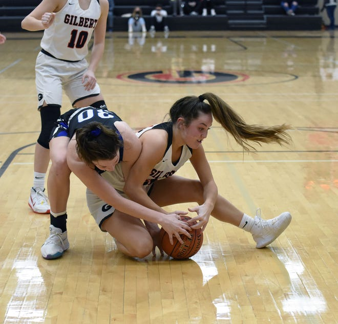 Gilbert's Emma Kruse fights Bondurant-Farrar's Katie Fogarty during the first half of the Tigers' 43-40 loss to the Bluejays Friday at Gilbert. The Tigers are scrapping hard, but haven't caught a break in two weeks in suffering their fourth-straight loss.