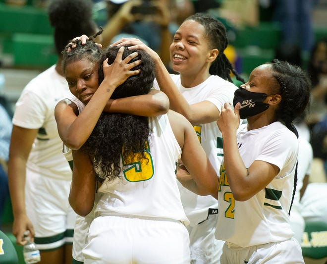 Josey's Jamirah Mitchell, left, celebrates with teammate Deajah Houck after a 46-43 win over Laney at the girls high school basketball game between TW Josey and Laney on Febuary 5, 2021 in Augusta, Ga. [MIKE ADAMS FOR THE AUGUSTA CHRONICLE]