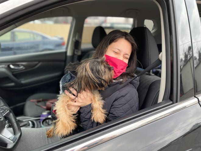 """Remy, a Yorkie mix, gives """"kisses"""" to Janelys Villalta of Augusta at Saturday morning's pet food drive at Golden Harvest Food Bank."""