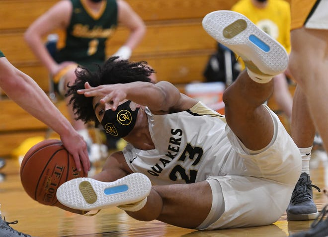 Quaker Valley's James Davis reaches for a loose ball during Friday night's game against Blackhawk.
