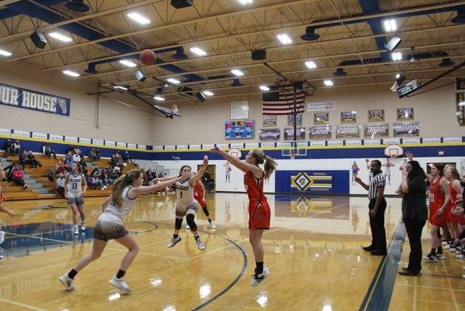 Ella Puckett (shooter) takes and makes a three-pointer in the 63-48 win over Wichita Collegiate on Friday, Feb. 5 at Wichita Collegiate HS in Wichita, KS.  The Junior finished with 27 points on nine made 3s.