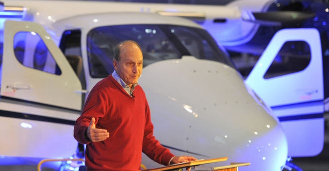 HYANNIS 10/16/19  Flanked by a new Italian Tecnam P2012 twin engine plane, Cape Air CEO Dan Wolf welcomes the crowd to his company's 30th birthday party and introduces the plane at the Rectrix hanger located at Barnstable Municipal Airport.