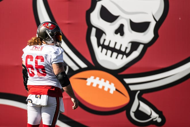 """""""It didn't take too long, really,"""" Buccaneers center Ryan Jensen said of building a rapport with quarterback Tom Brady."""