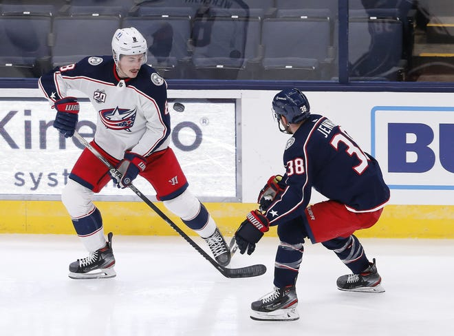 Defenseman Zach Werenski, left, shown in training camp on Jan. 6, missed practice Saturday with a lower-body injury. He was placed on injured reserve and is out up to two weeks.