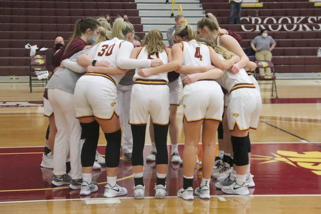 The Minnesota Crookston women's basketball team huddles before the start of a game Friday, Feb. 5 against Minnesota Duluth.