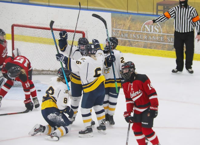 Reese Swanson (second on left) celebrates her third goal of the game with Aleah Bienek (8), Kenze Epema (6) and Addie Fee (2). Swanson's hat trick powered Crookston to a 4-2 win over Detroit Lakes Friday night.