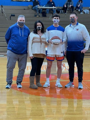 Randleman's Nate Cassidy was honored Friday for reaching 1,000 career points. Cassidy achieved that milestone earlier in the week.[Contributed photo]