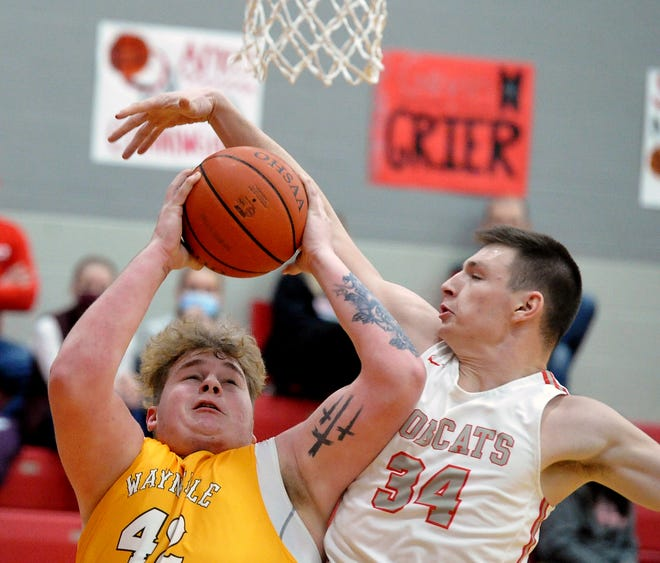 All-Daily Record first-teamers Hunter Hewitt and Jacob Rupp battle down low during one of their three regular-season matchups.