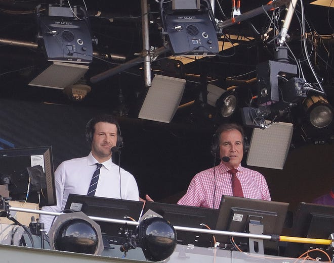 Tony Romo and Jim Nantz work in the CBS broadcast booth before a game between the Green Bay Packers and the Cincinnati Bengals. Nantz and Romo were inseparable when CBS broadcast the Super Bowl two years ago. Next week, they won't see each other until they are in the broadcast booth a couple hours prior to kickoff. Keeping announcers separated until game day has been standard practice this season due to the Coronavirus pandemic.