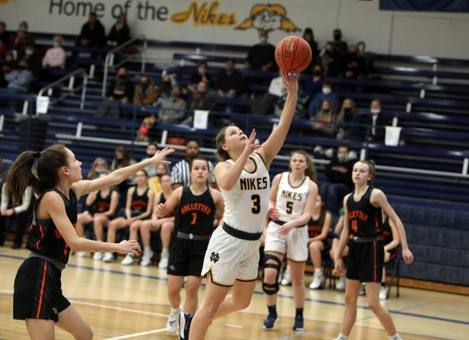 Notre Dame High School's Karli Artman (3) goes up for a basket during their SEI Superconference Shootout game against Mediapolis, Friday Feb. 5, 2021 at Notre Dame's Father Minett Gymnasium.