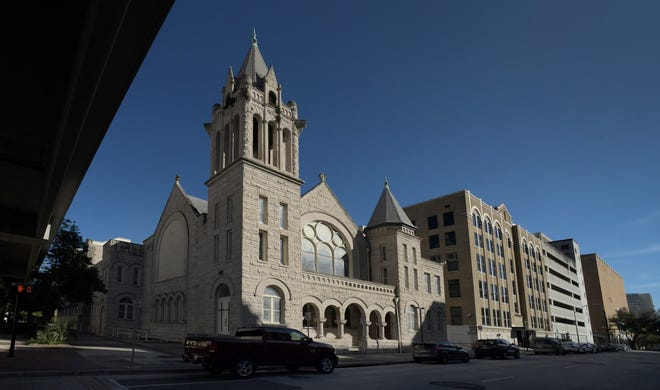 The historic First Baptist Church sanctuary building and part of the Hobson Block along West Church Street in downtown Jacksonville, Florida Thursday, January 14, 2021.