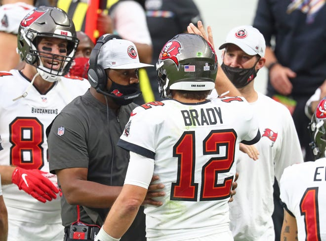 Tampa Bay Buccaneers quarterback Tom Brady (12) talks with offensive coordinator  Byron Leftwich during an October 25 game against the Las Vegas Raiders. Leftwich's stock as a future head coach should get a boost with the Bucs' presence in Super Bowl LV.