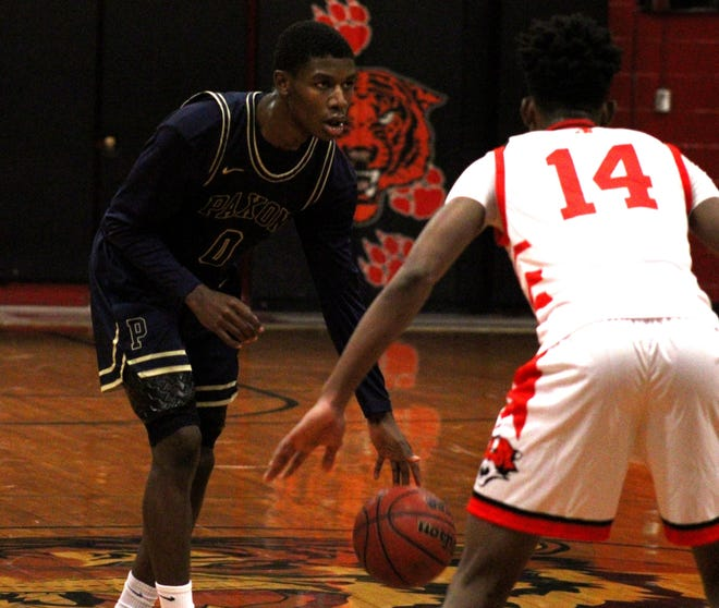 Paxon guard Ja'Kobe Williams (0) dribbles as Jackson guard Jackie Simmons III (14) defends during the Gateway Conference championship. Paxon and Jackson both hold top seeds for district tournaments.