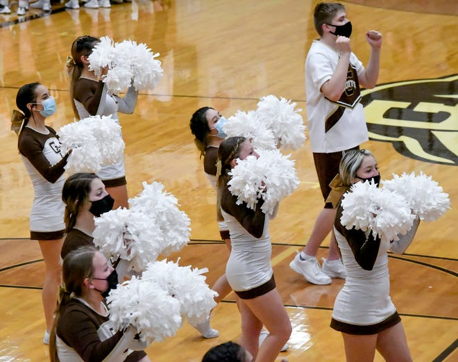 A portion of Garden City High School's cheerleaders are shown performing a cheer for the home crowd Friday at the GCHS/Guymon, Okla. basketball games at GCHS. Members of the squad, like all attending the games, wear face masks.