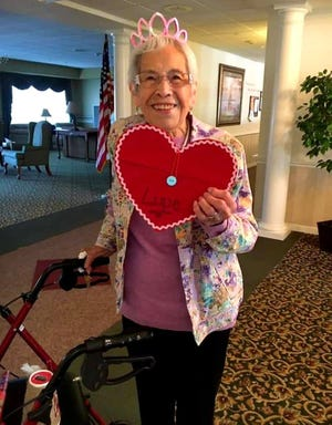 Lupe Perez of Galesburg poses for a photo on Valentine's Day 2019 at Woodridge Supported Living Residence in Galesburg. Perez, who turned 101 this past December, recently received a COVID-19 vaccine.