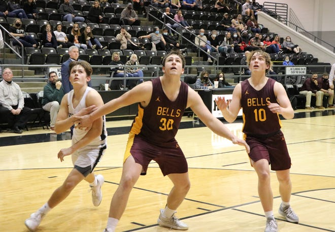 Bells' Cooper Smith (30) and Blake Rolen watch for a rebound along with Howe's Austin Haley in District 11-3A action at Howe.