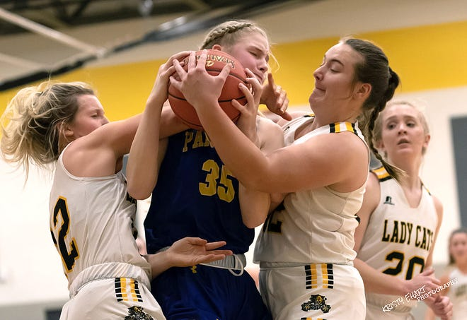 Nickerson's Ava Jones (35) battles with Haven's Brooke Brawner (12) left and Maguire Estill (42) during their game Friday night in Haven. Nickerson defeated Haven 57-46.