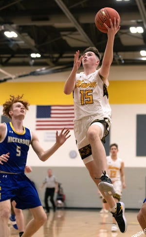 Haven's Zane Jacques (15) drives to the basket past Nickerson's Brayden Miller (5) during their game Friday night. Haven defeated Nickerson 54-28. Jacques was the team's high scorer with 21 points.